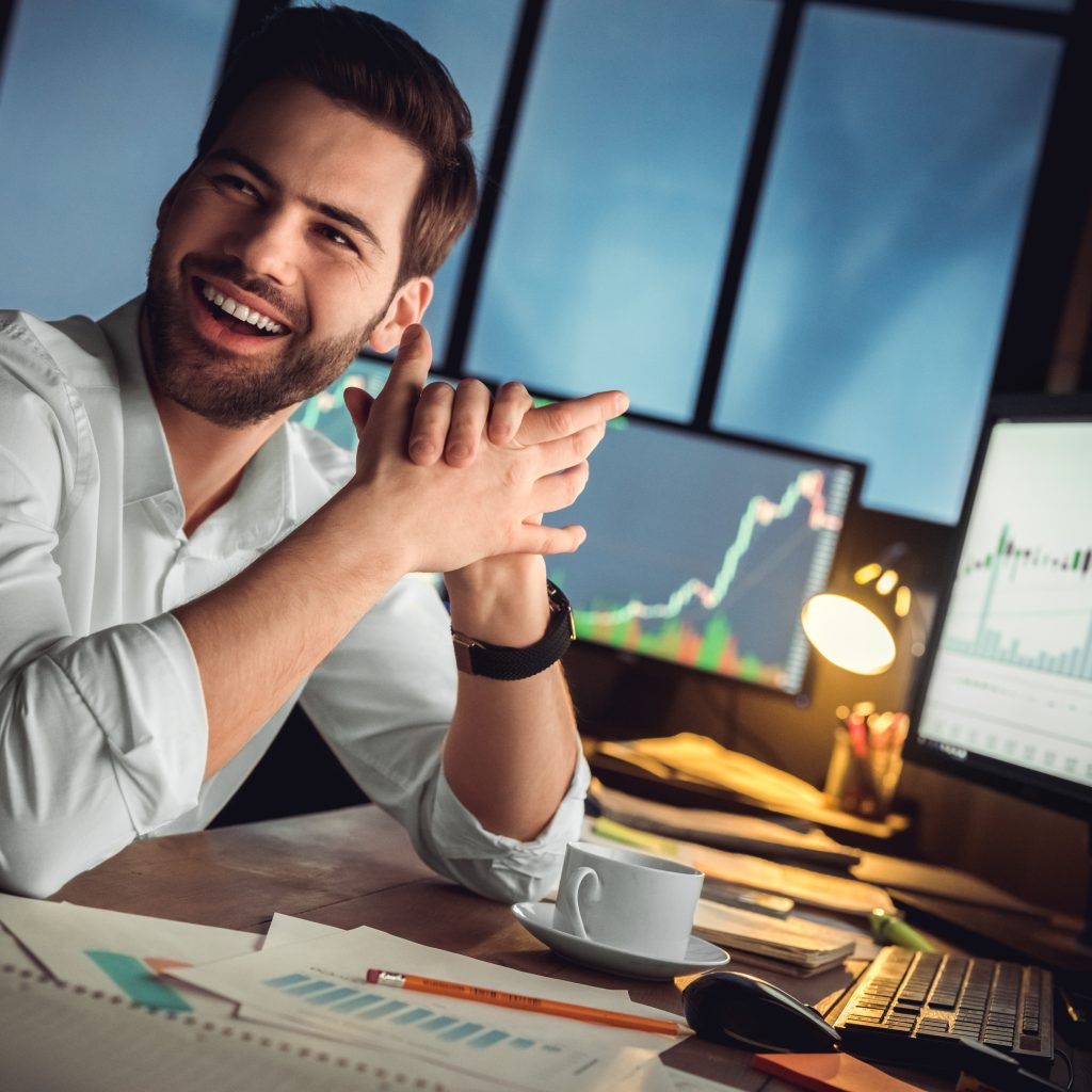 Trader Happy at a desk